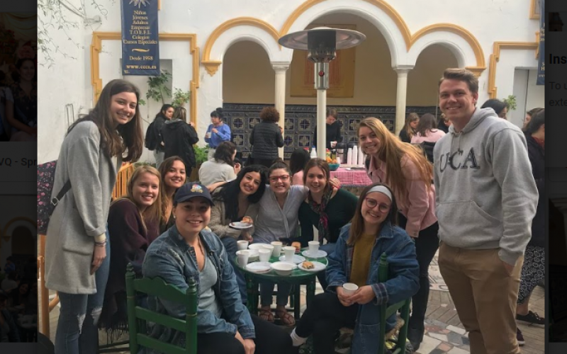 American Students Having Coffee Together In Seville